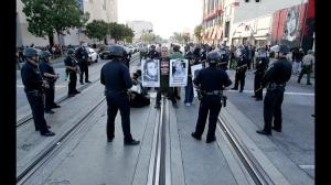 la-civil-rights-protesters-blocked-20150414-001